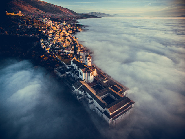 The winners in the third annual drone photography awards have been announced. Organised by the social network Dronestagram, the competition attracted more than 6,000 entries from amateur and professional drone enthusiasts across the world. Here: First place in the travel category went to the Basilica of Saint Francis of Assisi in Italy. (Photo by Francesco Cattuto)