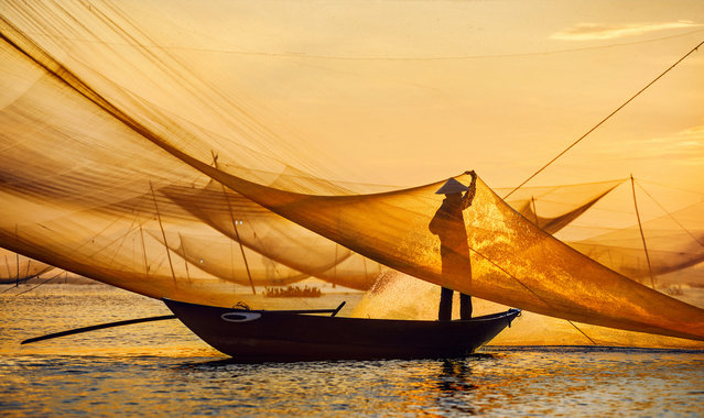 CGAP Photo Contest – New Day, New Nets, Vietnam. This man tends to his fishing nets in the early morning hours. He sells his catch at local markets later that day. (Photo by Tran Bao Hoa)