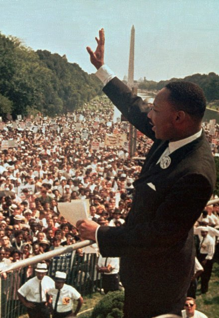 """Dr. Martin Luther King Jr. acknowledges the crowd at the Lincoln Memorial for his """"I Have a Dream"""" speech during the March on Washington, D.C. August 28, 1963.  (Photo by AP Photo)"""