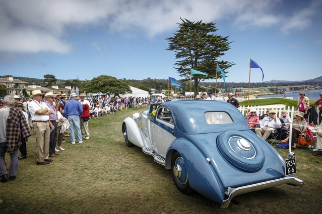This photo provided by Rolex, shows a 1934 Hispano-Suiza J12 Fernandez et Darrin Coupe de Ville, owned by Robert M. and Anne Brockinton Lee at the Rolex Monterey Motorsports Reunion during Monterey's Classic Car Week, Sunday, August 17, 2014, in Carmel, Calif. (Photo by Tom O'Neal/AP Photo/Rolex)
