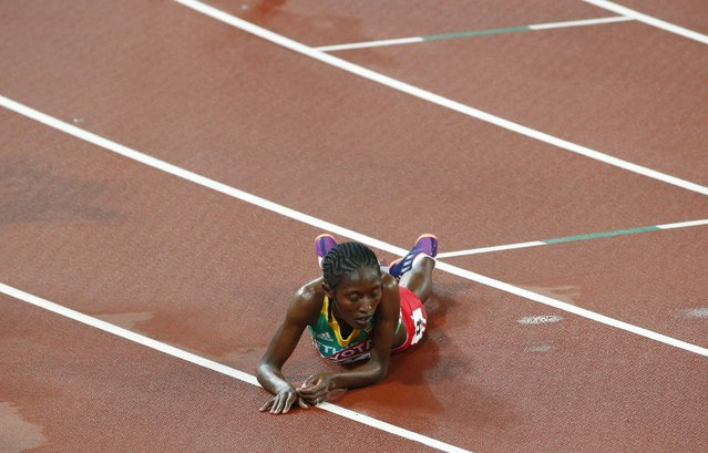Senbere Teferi of Ethiopia lies on the track after finishing second in the women's 5000 metres final at the 15th IAAF Championships at the National Stadium in Beijing, China August 30, 2015. (Photo by David Gray/Reuters)