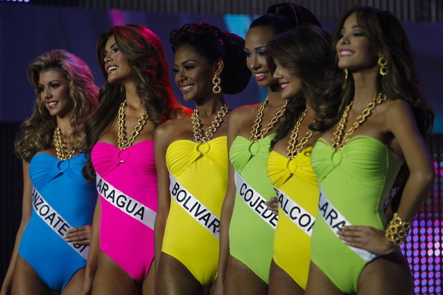 Contestants compete during the swimsuit segment of the Miss Venezuela 2012 pageant in Caracas August 30, 2012. The winner of the competition will participate in the 2013 Miss Universe pageant. (Photo by Carlos Garcia Rawlins/Reuters)