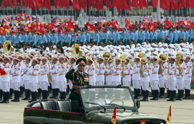 Lieutenant General Vo Van Tuan, deputy chief of general staff salutes as he leads a parade marking their 70th National Day at Ba Dinh square in Hanoi, Vietnam September 2, 2015. (Photo by Reuters/Kham)