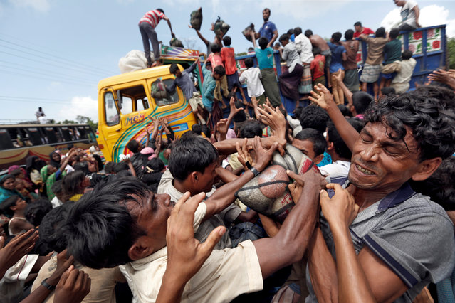 Rohingya refugees scuffle as aid is distributed in Cox's Bazar, Bangladesh, September 23, 2017. (Photo by Cathal McNaughton/Reuters)