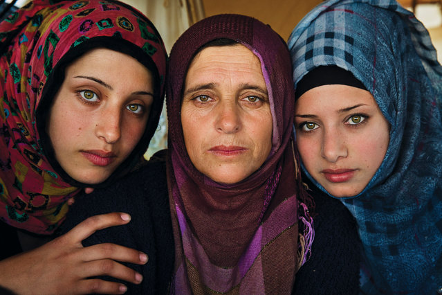 """Greece: """"This woman and her daughters fled the war in Syria"""". (Photo by Mihaela Noroc/The Guardian)"""