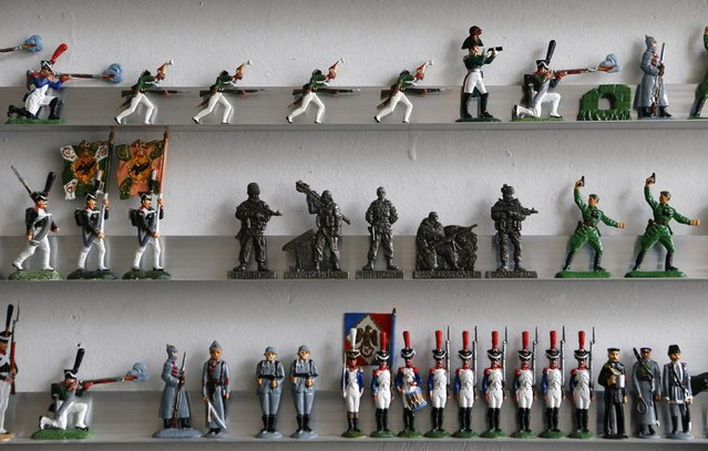 """Figurines, including those which depict pro-Russian separatist fighters (C), from the collection entitled """"Toy Soldiers of Novorossiya"""" are on display at a workshop in Moscow August 29, 2014. (Photo by Sergei Karpukhin/Reuters)"""