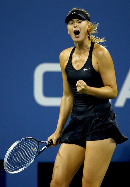 Maria Sharapova of Russia celebrates a point against Sabine Lisicki of Germany during their women's singles second round match on Day Five of the 2014 US Open at the USTA Billie Jean King National Tennis Center on August 29, 2014 in the Flushing neighborhood of the Queens borough of New York City. (Photo by Al Bello/Getty Images)