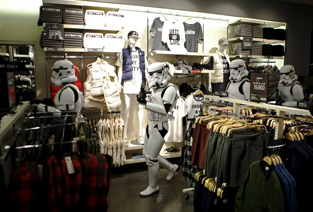 """Workers dressed as Storm Troopers from """"Star Wars"""" walk around  a clothing store at Myeongdong shopping district in Seoul, South Korea, September 4, 2015. (Photo by Kim Hong-Ji/Reuters)"""