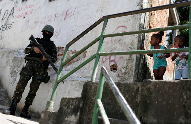 A member of the armed forces patrols the Morro dos Macacos slum during an operation against drug gangs in Rio de Janeiro, Brazil October 6, 2017. (Photo by Bruno Kelly/Reuters)