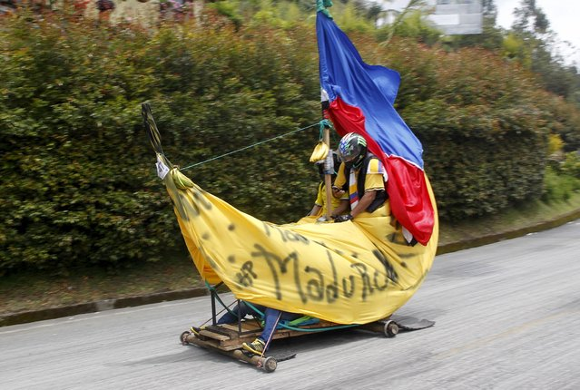 Participants descend a hill on a homemade cart during the 26th Roller Cart Festival in Medellin, Colombia September 6, 2015. (Photo by Fredy Builes/Reuters)