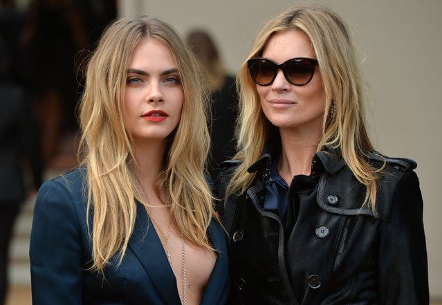 Cara Delevingne and Kate Moss attend the Burberry Prorsum show during London Fashion Week Spring Summer 2015 on September 15, 2014 in London, England. (Photo by Anthony Harvey/Getty Images)