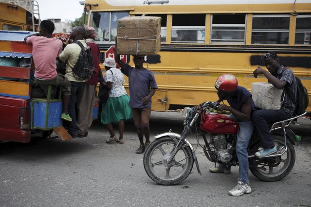 A moto-taxi driver tries to look ahead in traffic on a street in Port-au-Prince, Haiti, February 24, 2016. (Photo by Andres Martinez Casares/Reuters)