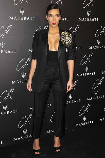 Kim Kardashian poses at Carine Roitfeld & Stephen Gan celebration of the launch of CR Fashion Book N.5 in Paris, Tuesday, September 30, 2014. (Photo by Zacharie Scheurer/AP Photo)