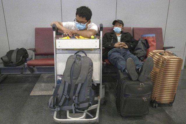 Passengers wait for their flight at the Beijing Capital Airport terminal 2 in Beijing on Wednesday, June 17, 2020. The Chinese capital on Wednesday canceled more than 60% of commercial flights and raised the alert level amid a new coronavirus outbreak, state-run media reported. (Photo by Ng Han Guan/AP Photo)