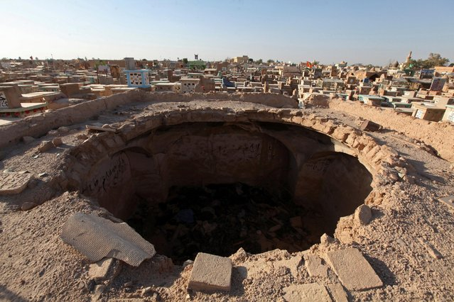 """Decayed dome is seen at the Wadi al-Salam cemetery, Arabic for """"Peace Valley"""", in Najaf, south of Baghdad, Iraq, August 3, 2016. (Photo by Alaa Al-Marjani/Reuters)"""