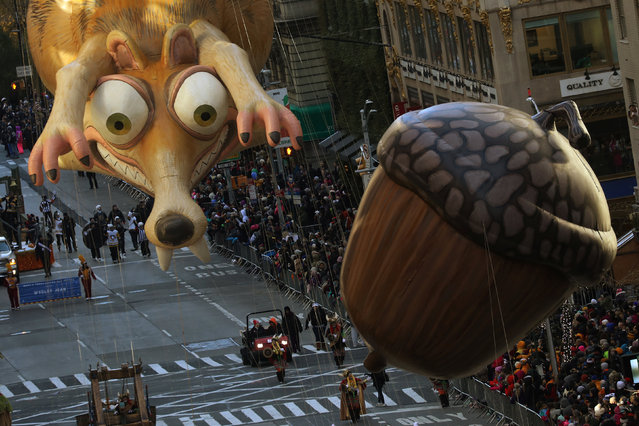 Ice Age's Scrat and his Acorn balloon during the 91st Macy's Thanksgiving Day Parade in the Manhattan borough of New York City, New York, U.S., November 23, 2017. (Photo by Carlo Allegri/Reuters)