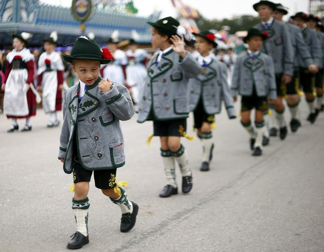 People dressed in traditional Bavarian clothes take part in the Oktoberfest parade in Munich, Germany, September 20, 2015. (Photo by Michael Dalder/Reuters)
