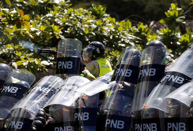 Riot police block a street during a rally to demand a referendum to remove Venezuela's President Nicolas Maduro in Caracas, Venezuela, September 1, 2016. (Photo by Carlos Garcia Rawlins/Reuters)
