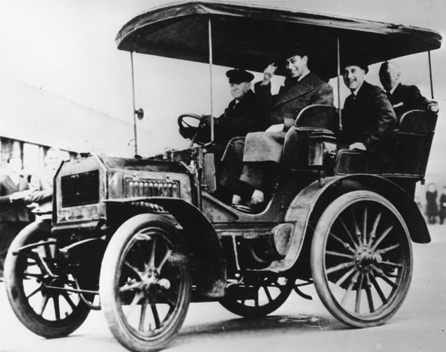 King George VI, grandson of King Edward VII, is shown taking a ride in a 1899 Daimler at the Daimler works in Coventry, England, on August 10, 1939. The Daimler was originally built for Edward VII when he was Prince of Wales. (Photo by AP Photo)