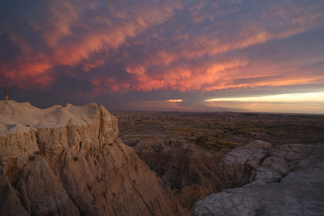 Clouds are transformed by a sunset at Badlands National Park Tuesday, July 26, 2016, in Interior, SD. (Photo by Jennifer Weiss/NBC News)