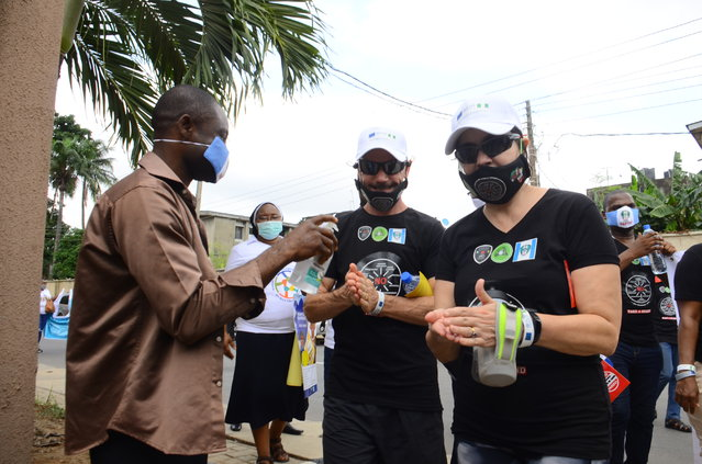 Activists sanitize their hands upon arrival after Mindful Giving Changes Lives walk in recognition of the World Day Against Trafficking in Persons in Lagos, on July 30, 2020.  (Photo by Olukayode Jaiyeola/NurPhoto via Getty Images)