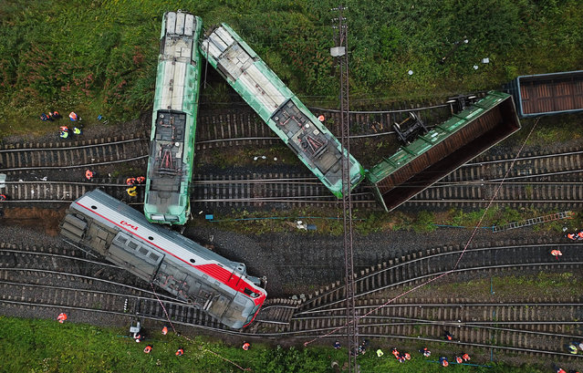 An aerial view of a scene of derailment at the Kupchinskaya railway station in Frunzensky District of St Petersburg, Russia on July 28, 2020. Two electric freight locomotives and an empty open wagon came off the rails after a tangential collsion between two freight trains. (Photo by Peter Kovalev/TASS/Sipa USA)