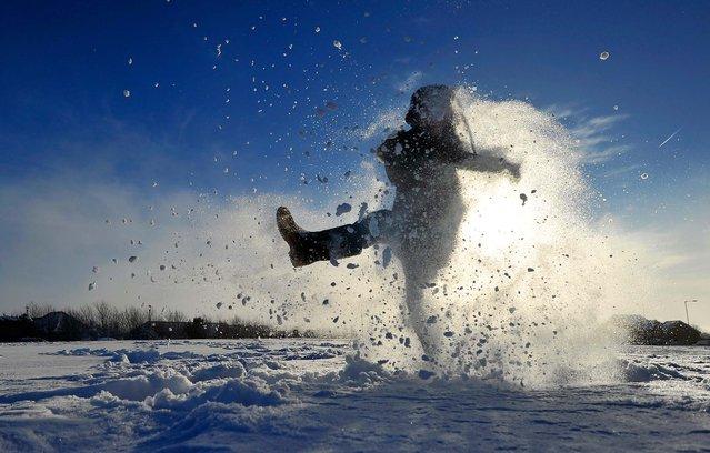 Archie Kirk plays in the snow in Brighton, England on December 3, 2010. (Glyn Kirk/AFP Photo)