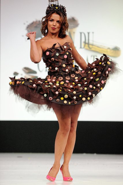 All models wears a creation made with chocolate during a fashion show at the inauguration of the 20th annual Salon du Chocolat in Paris, France on October 28, 2014. The show, the world's biggest dedicated to chocolate, brings together fashion designers and chocolatiers from around the world. (Photo by Jerome Domine/ABACA Press)