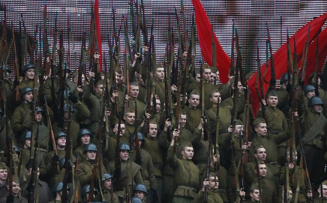 Men, dressed in historical uniforms, take part in a military parade in Red Square in Moscow, November 7, 2014. (Photo by Maxim Shemetov/Reuters)
