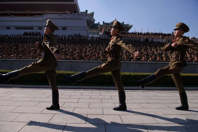 Members of a North Korean honour guard march past spectators prior to a mass military parade at Kim Il-Sung square in Pyongyang on October 10, 2015. (Photo by Ed Jones/AFP Photo)