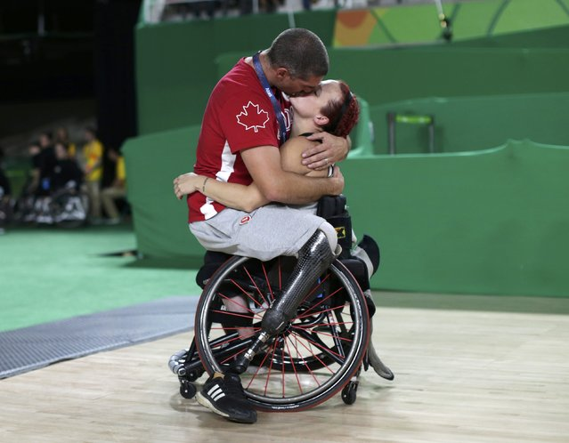 2016 Rio Paralympics, Wheelchair Basketball, Playoff, Women's Playoff, Canada vs China, Rio Olympic Arena, Rio de Janeiro, Brazil on September 16, 2016.  Canada's men's wheelchair basketball team player Adam Lancia kisses his wife Jamey Jewells of Canada after her match. (Photo by Ueslei Marcelino/Reuters)