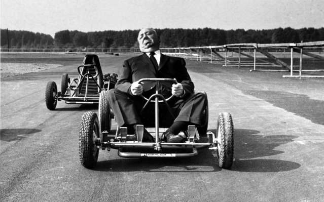British-born American filmmaker Alfred Hitchcock poses in a go-cart on a track specially built for go-carting outside Milan, Italy, October 12, 1960. (Photo by AP Photo)