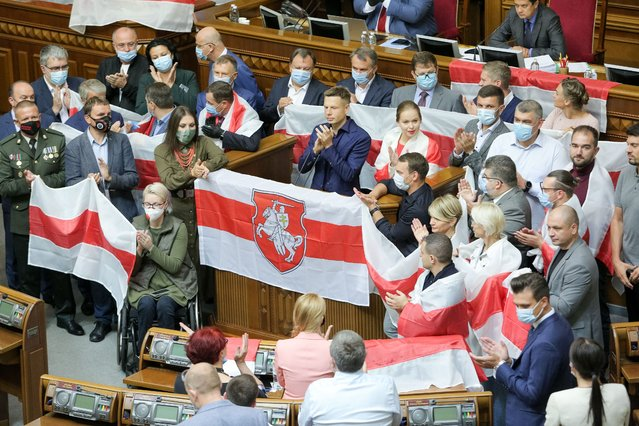 Lawmakers holds Belarus national flags in Parliamentary session room in Kyiv Ukraine, September 4, 2020. Lawmakers fill Parliamentary hall with Belarus national white-red-white flags to support its protesting citizens (Photo by Sergii Kharchenko/NurPhoto via Getty Images)