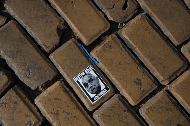 """A sticker with the face of the Bulgarian Prime minister Boyko Borissov is seen on the pavement in front of the National Assembly building on September 10, 2020 in Sofia, Bulgaria. On the top of Borissov reads """"Mafia out"""" and below him reads """"#resignation"""". For weeks now thousands of people have been taking part in daily protests against corruption, demanding the resignation of the government of Boyko Borissov, in power since 2009. (Photo by Hristo Rusev/Getty Images)"""