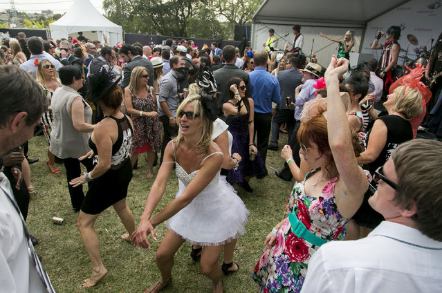 People dancing to a band playing at the end of the races during the Emirates Melbourne Cup Day held at Flemington Racecourse in Melbourne Australia, on November 4, 2014. (Photo by Asanka Brendon/Rex Features)