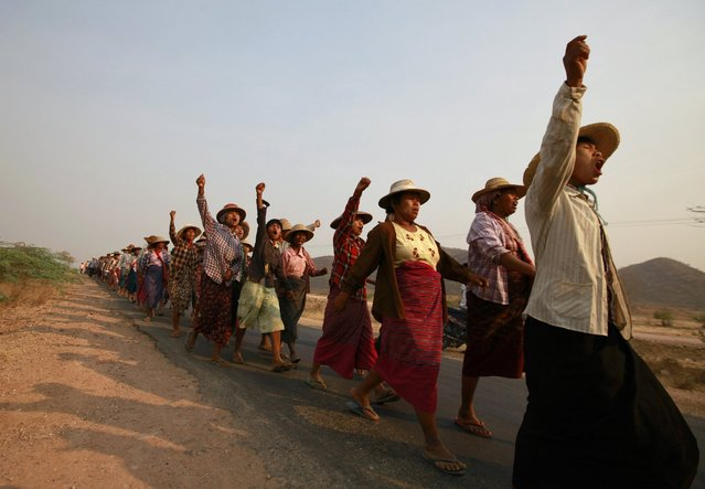 Villagers protest against a copper mine project in front of Lapdaung hill during a visit by Myanmar pro-democracy leader Aung San Suu Kyi in Sarlingyi township March 13, 2013. People whose land was seized to allow the expansion of the copper mine in northwestern Myanmar, prompted protests that were crushed by police, should be compensated before the project goes ahead, according to an official report published on Tuesday. (Photo by Soe Zeya Tun/Reuters)