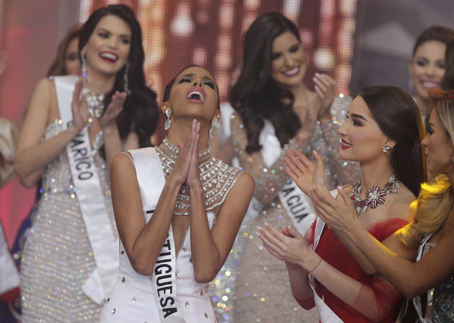 Miss Portuguesa Isabella Rodriguez reacts after being named Miss Venezuela during the annual beauty pageant in Caracas, Venezuela, on Thursday, December 13, 2018. (Photo by Fernando Llano/AP Photo)