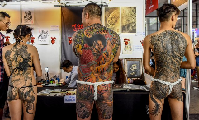 Contestants of a tattoo competition pose for photographs at the China TATTOO convention in Nanning, Guangxi Zhuang Autonomous Region, China, October 24, 2015. (Photo by Reuters/Stringer)