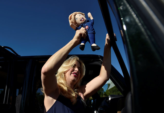 Mona Fishman of Las Vegas shakes a doll looking like Hillary Clinton before U.S. Republican presidential nominee Donald Trump speaks at a campaign rally in Henderson, Nevada October 5, 2016. (Photo by David Becker/Reuters)