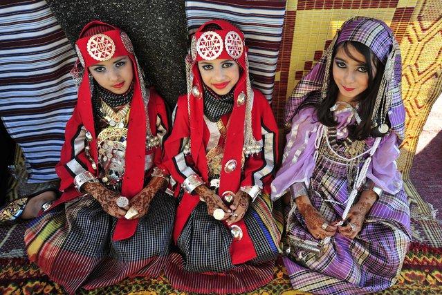 Girls wearing folk costumes participate in the Carnival Benghazi Capital of Culture 2013 in Benghazi, Libya, on April 18, 2013. (Photo by Esam Al-Fetori/Reuters)
