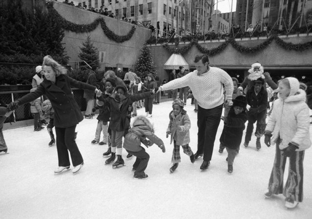 Ethel Kennedy, left, widow of the late Sen. Robert F. Kennedy, and Sen. Edward M. Kennedy, brother of Robert, skate with a young girl at New York's Rockefeller center skating rink, on December 18, 1971.   It was the seventh annual Christmas ice skating party sponsored by friends and family of the late New York senator for youngsters of the Bedford-Stuyvesant area of Brooklyn. (Photo by Jim Wells/AP Photo)