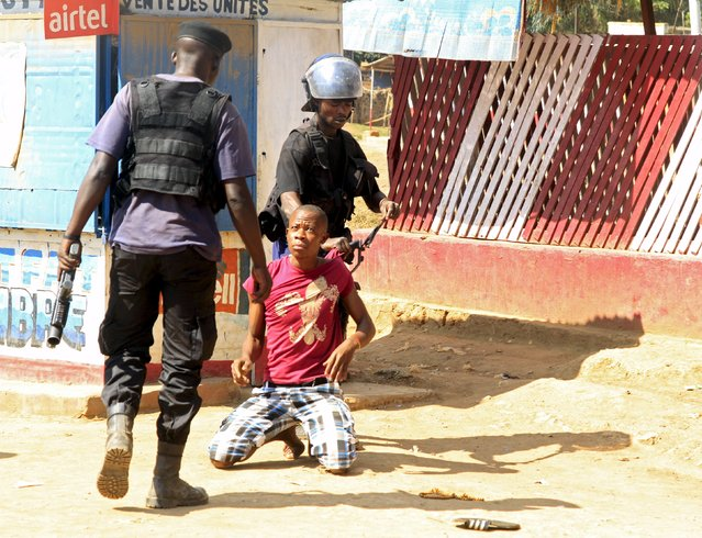 Policemen detain a protester during clashes in Lubumbashi, Democratic Republic of Congo November 10, 2015. Police fired tear gas at hundreds of people armed with sticks and shovels protesting the arrest of several youth leaders in Congo's second largest city of Lubumbashi on Tuesday, a Reuters witness said. (Photo by Kenny Katombe/Reuters)