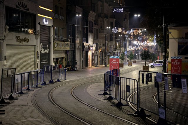 A view of empty Istiklal Street is seen after a general curfew imposed weekend-long from Friday 9 p.m. to Monday 5 a.m. local time within new measures against a second wave of the COVID-19 pandemic, at Galata bridge in Istanbul, Turkey on December 05, 2020. (Photo by Mehmet Eser/Anadolu Agency via Getty Images)