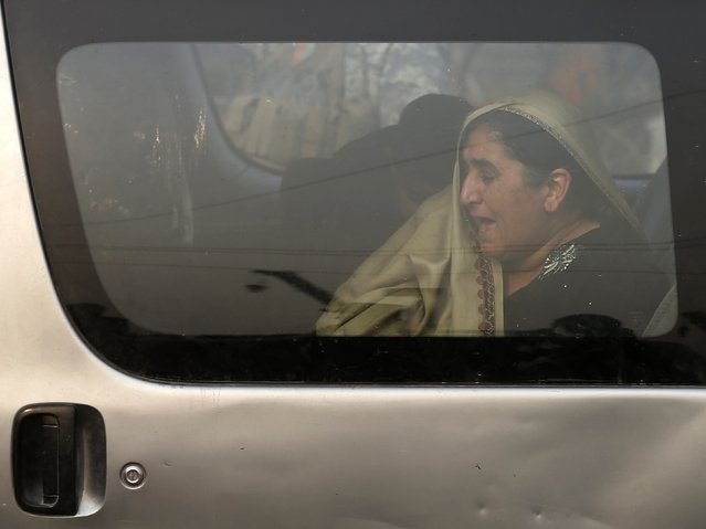 An Afghan woman cries as she sits inside a car at the site of a suicide attack in Kabul January 5, 2015. (Photo by Mohammad Ismail/Reuters)