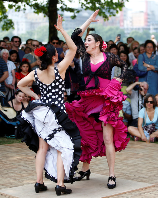 Flamenco dancers perform on the South Bank during an Andalusian carnival, in central London, Britain May 27, 2018. (Photo by Henry Nicholls/Reuters)