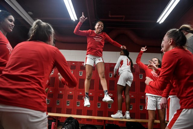 Regis Jesuit guard Jada Moore jumps off of a bench as she hypes teammates before the first half of a basketball game against ThunderRidge on Tuesday, January 21, 2020. (Photo by Aaron Ontiveroz/The Denver Post)