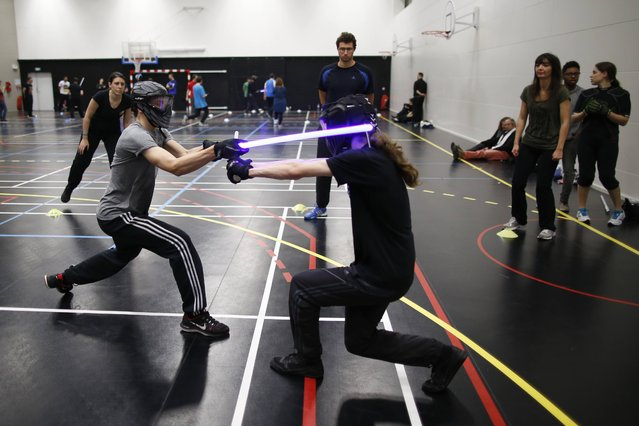 Competitors participate in a light saber duel tournament organized by the Sport Saber League in Paris, France, October 29, 2015. (Photo by Charles Platiau/Reuters)