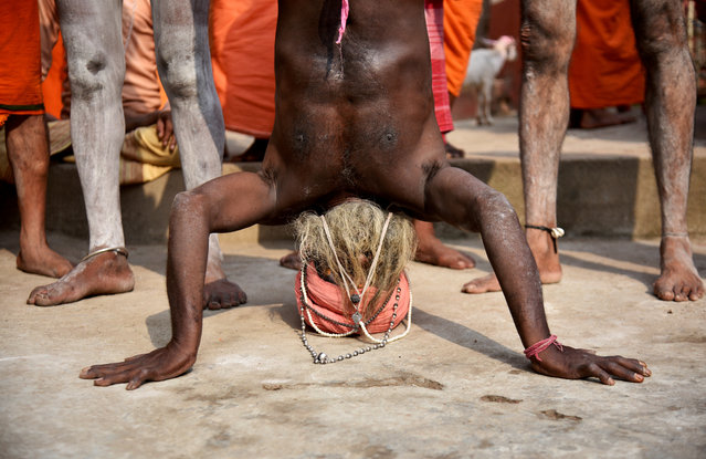 A Sadhu, or a Hindu holy man, performs yoga on International Yoga Day at Kamakhya temple in Guwahati, India on June 21, 2018. (Photo by Anuwar Hazarika/Reuters)