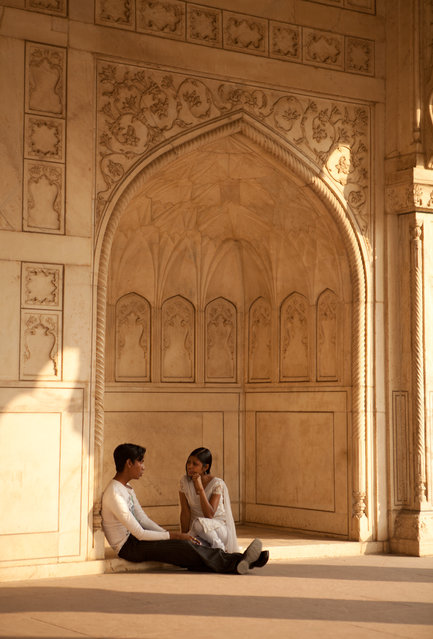 """A Guardian Watches Over The Lovers"". Late in the afternoon the light was just right. The pillars created a guardian shaped figure as if watching over the two lovers as they remained entranced in each others company. Location: Agra, India. (Photo and caption by Sam Hawley/National Geographic Traveler Photo Contest)"