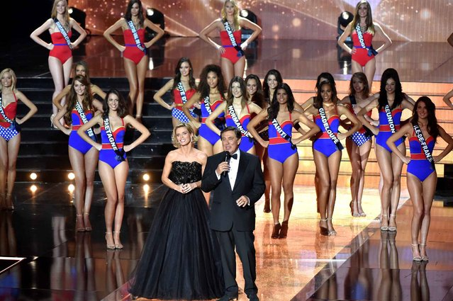 TV host Jean-Pierre Foucault (foreground C) and general director of Miss France Society Sylvie Tellier present the Miss France 2016 beauty pageant, on December 19, 2015 in Lille, northern France. (Photo by Philippe Huguen/AFP Photo)